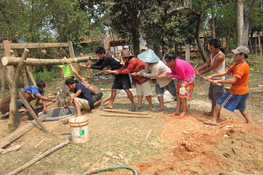 Community members are building a well as part of a Child Aid project