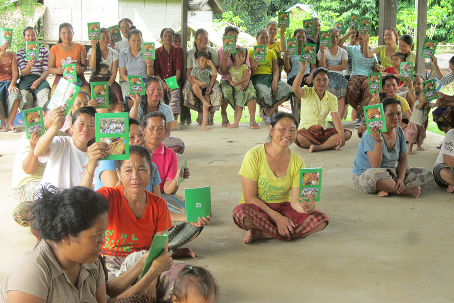 Mothers are presenting their household log books after signing up for Village Action Groups