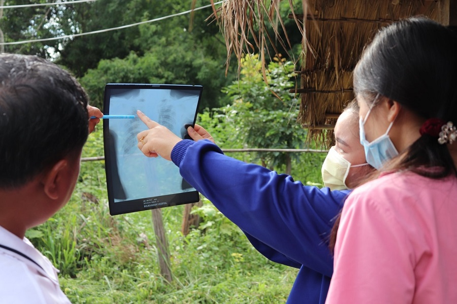 Medical staff and HPP Laos field staff are examining a chest X-ray of a presumptive TB client