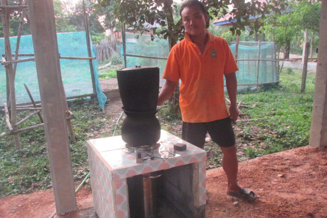 One of the participants with his gasifier, inside its protective stove