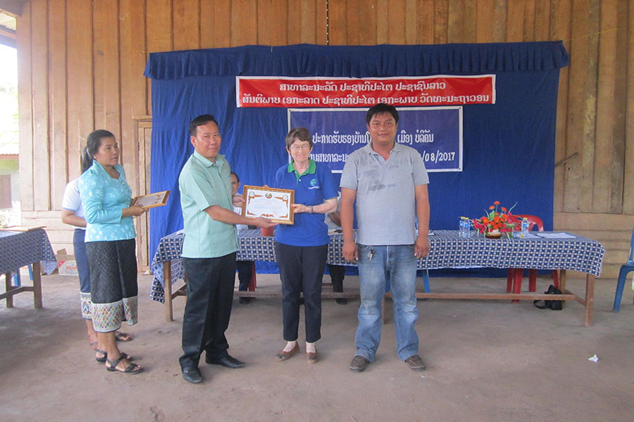 HPP Laos receives a certificate in recognition of our support for the newly awarded Model Health Villages