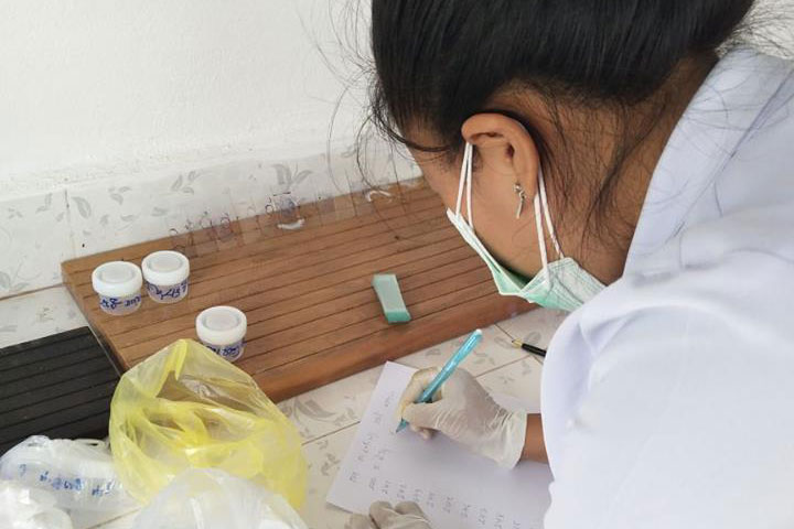 Hospital staff in Bolikhan District Hospital are checking sputum samples